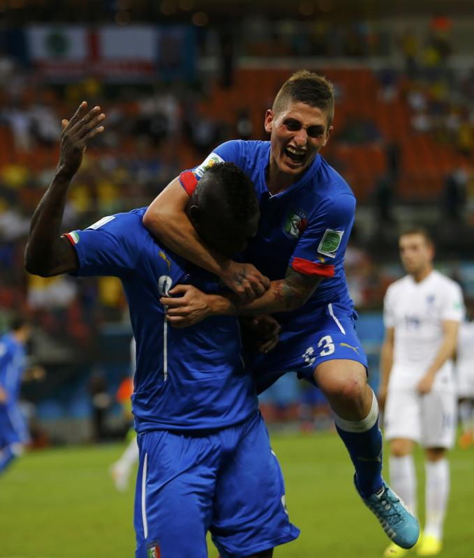 Italy's Balotelli celebrates his goal against England with Verratti during their 2014 World Cup Group D soccer match at the Amazonia arena in...