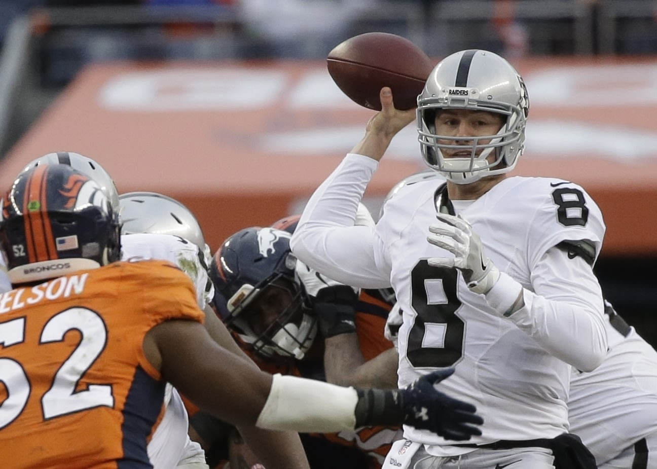 Quarterback Connor Cook, right, will make his first career start for the Oakland Raiders in their first postseason game in 14 years. (AP)