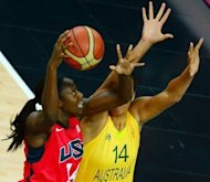 Australian center Elizabeth Cambage (R) challenges US centre Tina Charles during the London 2012 Olympic Games women's semifinal basketball match. Four-time defending champion United States advanced to the Olympic women's basketball final with an 86-73 victory over Australia