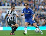 Chelsea's striker Fernando Torres (R) clashes with Newcastle United's midfielder Yohan Cabaye during their English Premier League football match at Stamford Bridge in London. Chelsea won 2-0