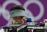 Chinese athlete Yi Siling competes in the 10m air rifle final at the London 2012 Olympic Games at the Royal Artillery Barracks in London