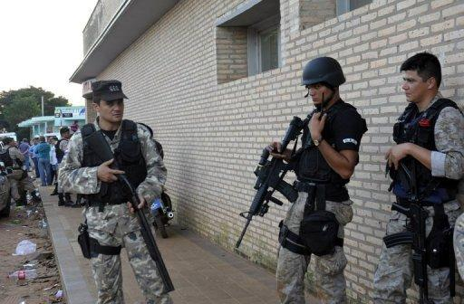 Security forces stand guard around a health centre in Curuguaty