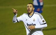 Real Madrid's French striker Karim Benzema, pictured in October 2012, will miss Tuesday's Champions League game against German champions Borussia Dortmund, coach Jose Mourinho revealed on Monday