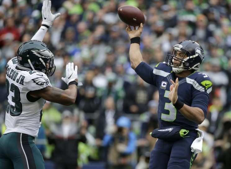 Russell Wilson throwing against Philadelphia, before he caught a touchdown pass (AP)