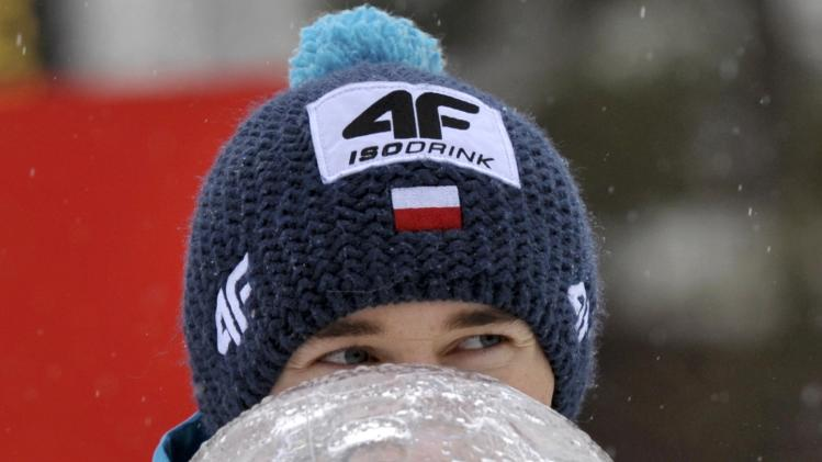 Overall winner Stoch of Poland kisses his trophy after the men's large hill individual FIS World Cup ski jumping final event in Planica
