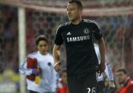 Chelsea's John Terry reacts as he walks on the pitch after being injured during their Champions League semi-final first leg soccer match against Atletico Madrid at Vicente Celderon Stadium in Madrid, April 22, 2014. Picture taken April 22, 2014. REUTERS/Javier Barbancho (SPAIN - Tags: SPORT SOCCER)