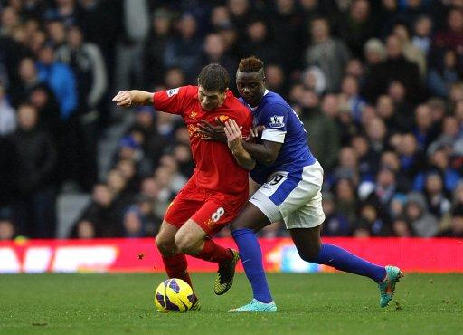 Steven Gerrard, left, was bemoaning refereeing decisions after the Merseyside derby