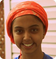 A long scarf is used to tie a head wrap.