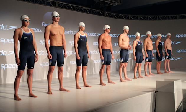Athletes from the United States swim team model highly technical swimsuits during a news conference debuting Speedo's new Fastskin 3 swimsuit in New York, Wednesday, Nov. 30, 2011. Olympic gold medali