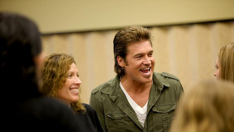 "Billy Ray Cyrus with the ladies of the FRG, Family Readiness Group as seen on ""Surprise Homecoming."""