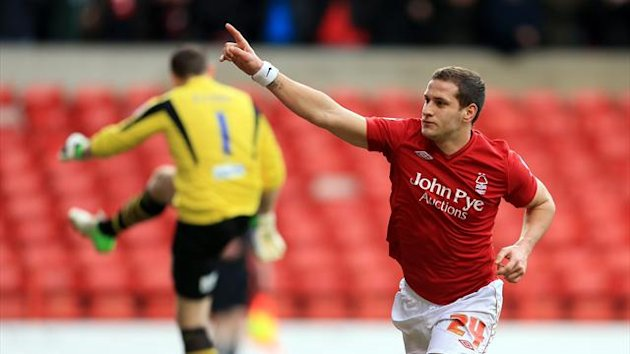 Nottingham Forest's Billy Sharp celebrates scoring their first goal from the penalty spot