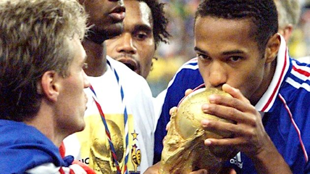 Thierry Henry kisses the World Cup trophy after France's triumph in 1998 (AFP)