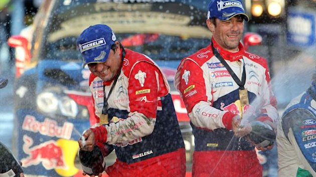 Sebastian Loeb of France (R) and co driver Daniel Elena of Monaco celebrate after driving their Citroen DS3 to win the Rally New Zealand, round 7 of the World Rally Championship, in Auckland on June 24, 2012 (AFP)