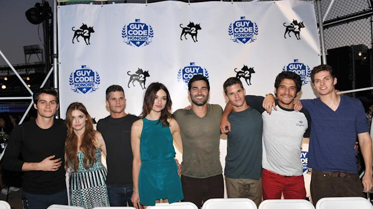 Cast of 'Teen Wolf' from left, Dylan O'Brien, Holland Roden, Charlie Carver, Crystal Reed, Tyler Hoechlin, Max Carver, Tyler Posey and Daniel Sharman attend MTV2's Party in the Park on Day 2 of Comic-Con International on Thursday, July 18, 2013 in San Diego, Calif. (Photo by John Shearer/Invision for MTV2/AP Images)