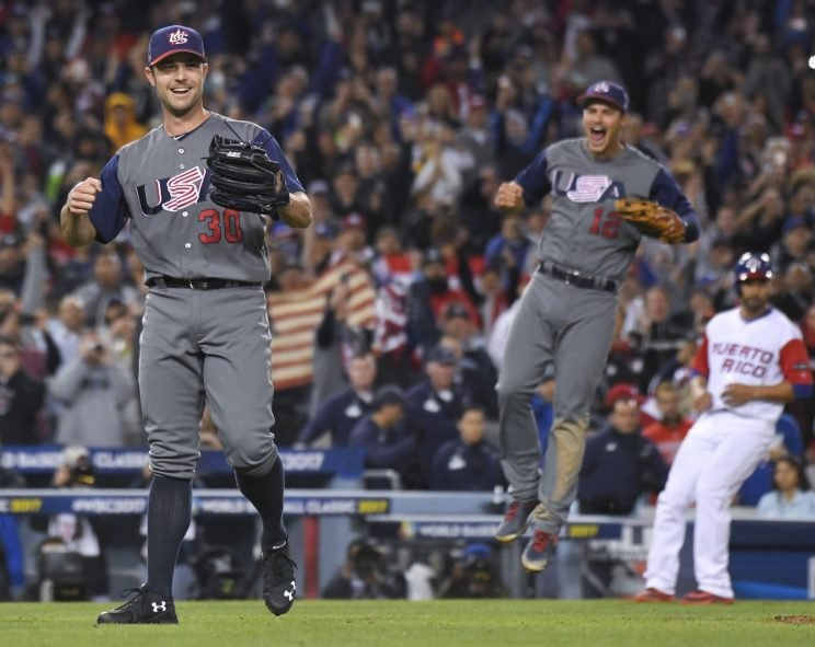 U.S. pitcher David Robertson, left, and infielder Nolan Arenado celebrate the team's 8-0 win over Puerto Rico in the final of the World Baseball Classic in Los Angeles, Wednesday, March 22, 2017. (AP Photo/Mark J. Terrill)