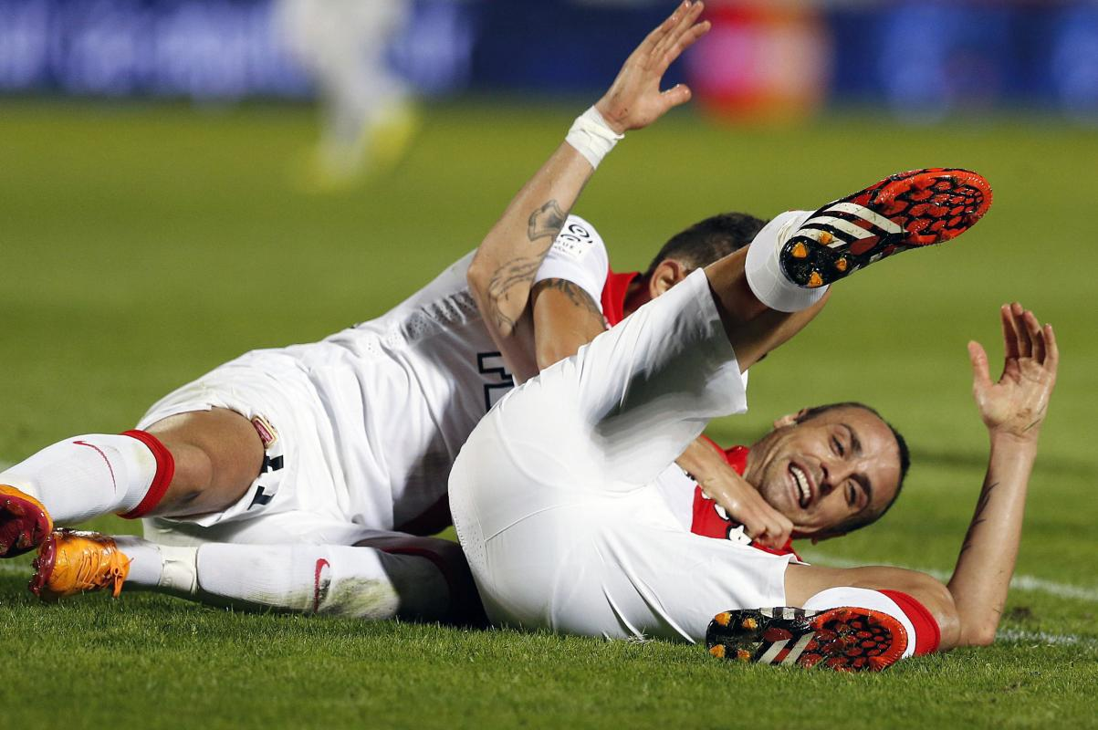 Dimitar Berbatov celebrates with his team mate Lucas Ariel Ocampos after scoring against Girondins Bordeaux, during their French Ligue 1 soccer match ...
