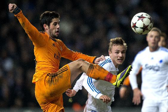 Real Madrid's Isco Suarez, left,  and FC Copenhagen's Pierre Bengtsson vie for the ball,  during the Champions League, Group B, soccer match between FC Copenhagen and Real Madrid, at Parken in Copenhagen, Denmark, Tuesday Dec. 10, 2013