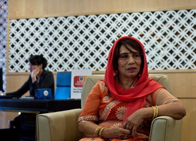 Bangladeshi woman Nusrat Hussein Kiwan sits at the International Patients Centre reception area, at a private hospital in Kuala Lumpur, on December 9, 2014
