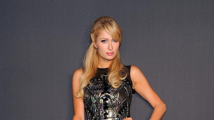 "Television personality Paris Hilton arrives at a ""Lady Gaga Fame"" fragrance launch event at the Guggenheim Museum on Thursday, Sept. 13, 2012 in New York. The black tie masquerade event will feature a performance art piece by Lady Gaga, ""Sleeping with Gaga."" The film for ""Lady Gaga Fame"", directed by Steven Klein, will also be unveiled during the evening. (Photo by Evan Agostini/Invision/AP)"