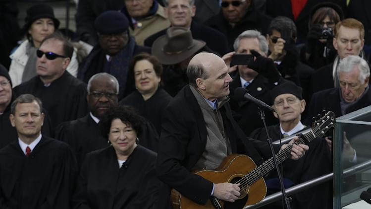 Singer James Taylor performs at the ceremonial swearing-in at the U.S. Capitol during the 57th Presidential Inauguration in Washington, Monday, Jan. 21, 2013. (AP Photo/Paul Sancya)