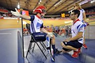 Britain's Jody Cundy (L) talks with para-cycling coach Chris Furber (R) after being denied a restart in the men's individual C4-5 1km time trial cycling event during the London 2012 Paralympic Games at the Olympic Park's Veldrome in east London on August 31, 2012