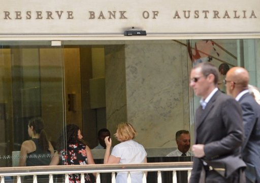 People walk past the Reserve Bank of Australia office in central Sydney on November 6. Australia's central bank on Tuesday cut the official interest rate by 25 basis points to 3.0%, its lowest level since the depths of the 2009 financial crisis.