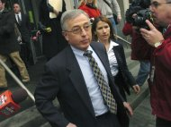 "FILE - In this Feb. 12, 2009 file photo, former judge Mark Ciavarella, center, leaves the federal courthouse in Scranton, Pa. The film ""Kids for Cash"" set to open explores the scandal that entangled thousands of children in Pennsylvania's juvenile court system and sent two former judges to prison. Ciavarella is serving a 28-year sentence and fellow ex-judge Michael Conahan 17 years for taking $2.6 million from companies looking to build and fill a youth detention center for Luzerne County. (AP Photo/David Kidwell, File)"