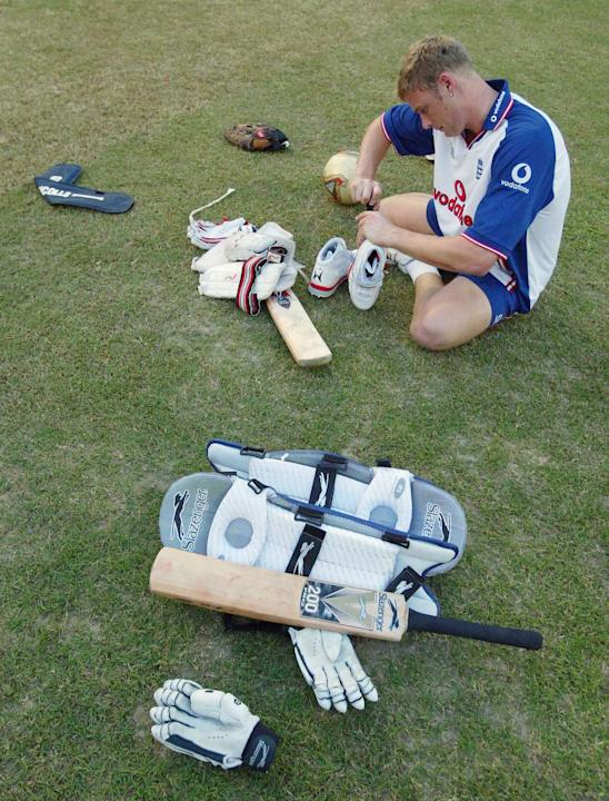 CHITTAGONG, BANGLADESH - NOVEMBER 6:  Andrew Flintoff of England tightens his boot studs during a practice session prior to the first One Day International match between the Bangladesh and England at