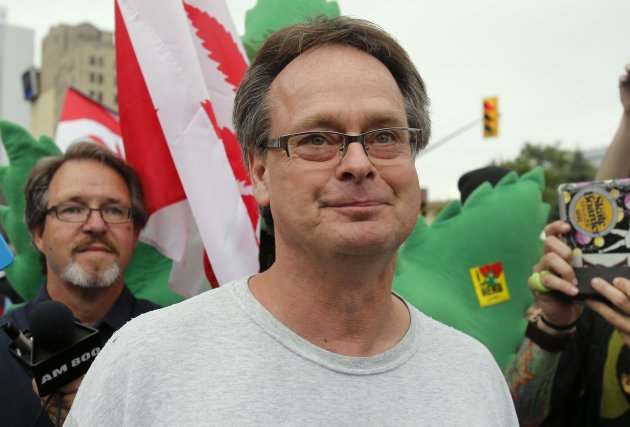 Marijuana advocate Marc Emery walks down a street followed by his supporters following his release from an American prison for selling marijuana seeds in the U.S., in Windsor, Ontario August 12, 2014. REUTERS/Rebecca Cook (CANADA - Tags: DRUGS SOCIETY CRIME LAW)