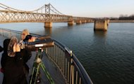 Chinese people look across a river to North Korea in 2010 in Dandong, Liaoning province. A teenager has been arrested after killing nine people and wounding four others in a knife attack in northeast China, state media reported Thursday