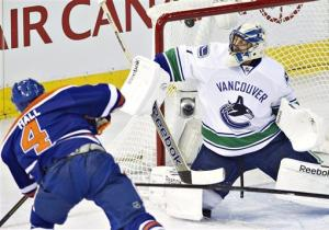 Hall's hat trick sinks Canucks 4-0