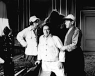 "In this undated image originally released by Columbia Pictures, from left, Larry Fine, Curly Howard and Moe Howard are shown in a scene from a ""The Three Stooges,"" film. Filmmakers Peter and Bobby Farrelly have created a remake of the popular comedy trio starring Sean Hayes, Will Sasso and Chris Diamantopoulos. (AP Photo/Columbia Pictures)"