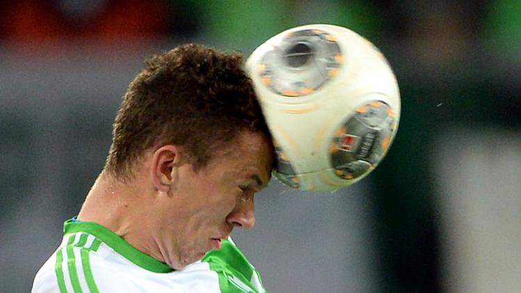 Wolfsburg's Ivan Perisic stops the ball with his head during the German Bundesliga match between VfL Wolfsburg and Werder Bremen at Volkswagen Arena in Wolfsburg,Germany,  Saturday Oct. 26, 2013