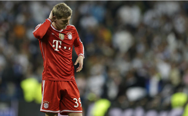Bayern's Toni Kroos touches his head after a Champions League semifinal first leg soccer match between Real Madrid and Bayern Munich at the Santiago Bernabeu stadium in Madrid, Spain, Wednesday, A