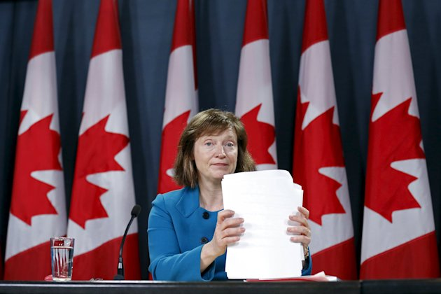 Canada's Information Commissioner Suzanne Legault shuffles papers during a news conference upon the release of her report in Ottawa March 31, 2015. REUTERS/Chris Wattie