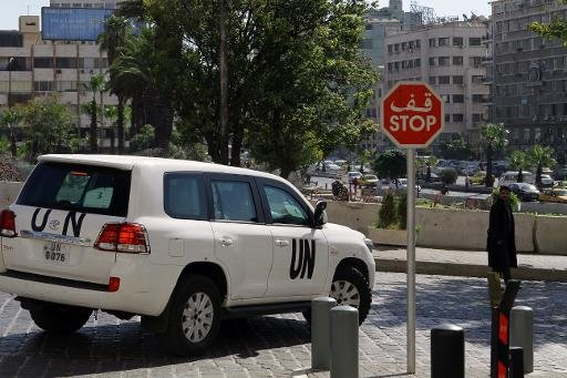 A UN vehicle carrying inspectors from the Organisation for the Prohibition of Chemical Weapons (OPCW) leaves a hotel in Damascus on October 7, 2013