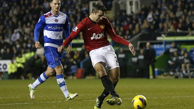 Robin van Persie of Manchester United scores against Reading