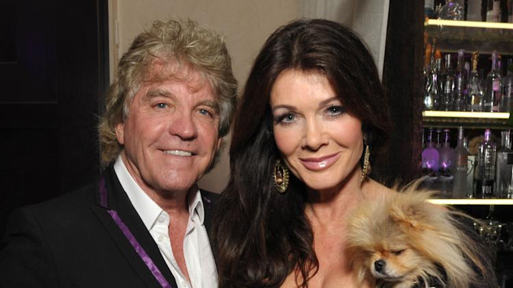 "Ken Todd, Lisa Vanderpump, and their dog Giggy attend the premiere party for ""Vanderpump Rules"" at SUR restaurant, on Monday, Dec. 10, 2012 in Los Angeles. The show premieres on January 7, 2013 on Bravo.  (Photo by John Shearer/Invision for Bravo/ AP Images)"