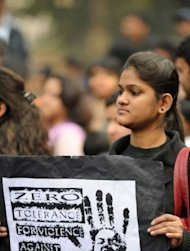 An Indian demonstrator holds a placard during a protest calling for better safety for women following the rape of a student in the Indian capital, in New Delhi on December 27, 2012. An Indian gang-rape victim died Saturday in Singapore after suffering severe organ failure, the hospital treating her said, in a case that sparked widespread street protests over violence against women