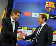 Barcelona's president Sandro Rosell (R) shakes hands with Barcelona's new coach Tito Vilanova during Vilanova's official presentation at the Camp Nou stadium in Barcelona. Vilanova worked as number two to Pep Guardiola who gave up the job at the end of the season after four years in charge