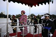 Joyce Banda inspects the guard of honour during her inauguration. She faces the challenge of leading a country whose parliament is dominated by Mutharika's party, at the head of a cabinet that includes ministers vocally opposed to her