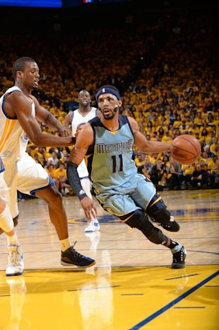 OAKLAND, CA - MAY 5: Mike Conley #11 of the Memphis Grizzlies drives to the basket against the Golden State Warriors in Game Two of the Western Conference Semifinals during the NBA Playoffs on May 5, 2015 at ORACLE Arena in Oakland, California. (Photo by Noah Graham/NBAE via Getty Images)