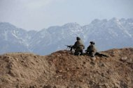 French soldiers keep watch during an operation in Surobi district, Kabul province on March 14, 2012. NATO has some 130,000 troops in Afghanistan helping the government of President Hamid Karzai fight an insurgency by Taliban militants ousted from power in a 2001 US-led invasion