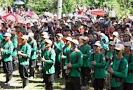 This photo taken on December 26, 2010 shows New People's Army (NPA) guerrillas attending a ceremony in the southern island of Mindanao. The Philippine government has accused the Maoist rebel group of violating a self-imposed truce in typhoon-hit areas with attacks on government forces involved in rescue and relief work
