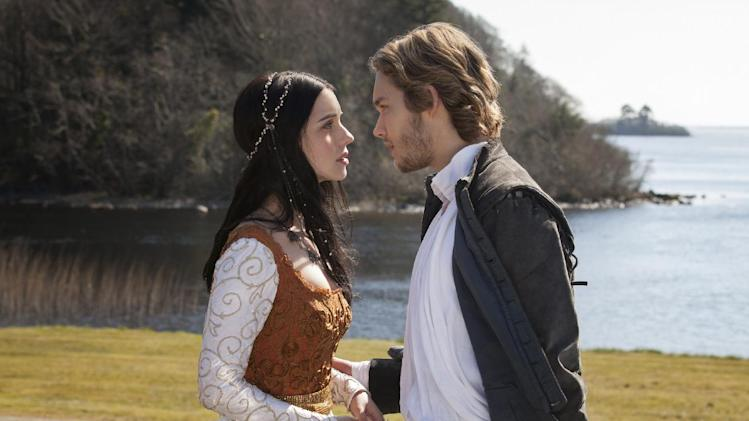 "This publicity image released by The CW shows Adelaide Kane as Mary, Queen of Scots, left, and Toby Regbo as Prince Francis in a scene from the new series ""Reign,"" premiering this fall on The CW. (AP Photo/The CW, Joss Barratt)"
