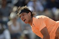 Spain's Rafael Nadal serves to his compatriot David Ferrer during their semi-finals match of the ATP Rome tournament. Nadal dominated Ferrer 7-6 (8/6), 6-0 to power into a seventh Rome Masters final, beating his fellow Spaniard for the 12th consecutive time on clay