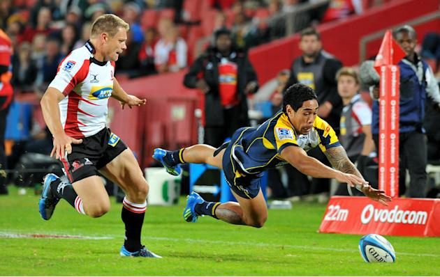 Brumbies (AUS), Centre Joseph Tomane (R) takes a dive as Lions (RSA) Right Wing Deon Van Rensburg looks on during the Super 15 Rugby Match between Lions and  Brumbies at Ellis Park, Stadium in Johanne