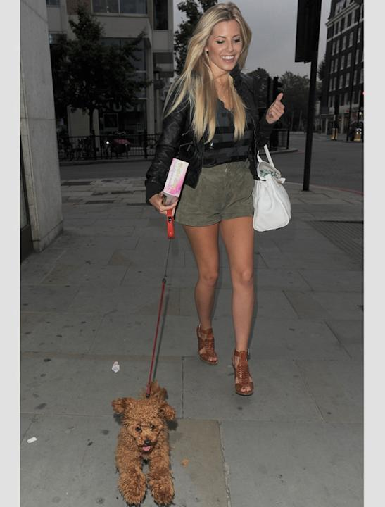 Celebrity pets: Mollie King looks as if she's struggling to restrain her excitable poodle, Alfie.