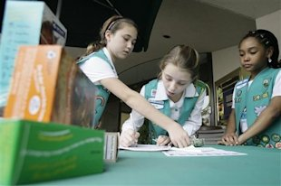 Girl Scouts selling cookies in Dallas, Texas. (AP Photo/Matt Slocum)