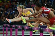 Australia's Sally Pearson (L) competes in the women's 100m hurdles final at the athletics event during the London 2012 Olympic Games on August 7, 2012 in London. Pearson clocked an Olympic record of 12.35sec